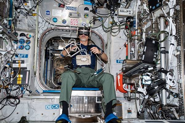 image of an astronaut working with a VR experiment