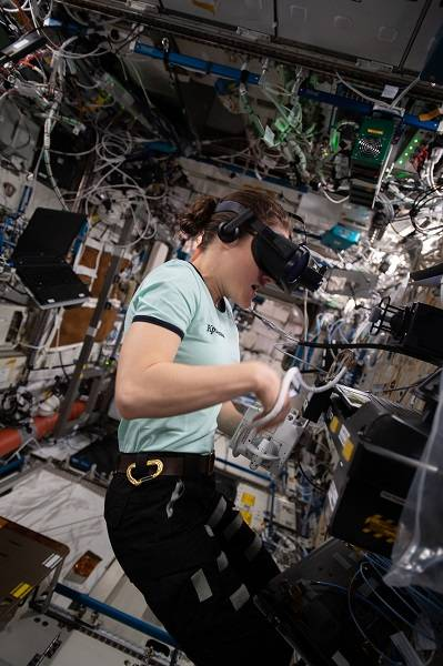 image of astronaut working with a VR experiment