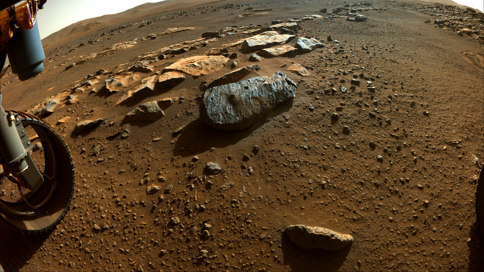 """The rock, nicknamed """"Rochette,"""" from which NASA's Perseverance rover obtained its first core samples, seen with two holes drilled in it."""