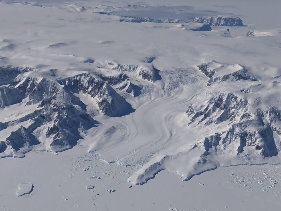 Bluish-white frozen, mountainous landscape