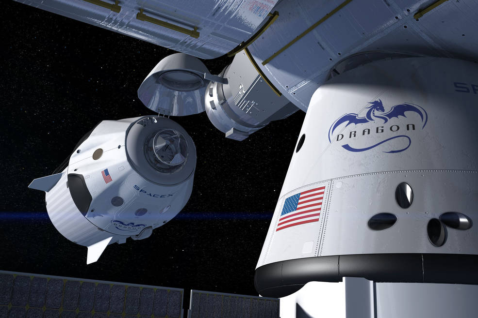 artist's concept shows a SpaceX Crew Dragon docking with the International Space Station