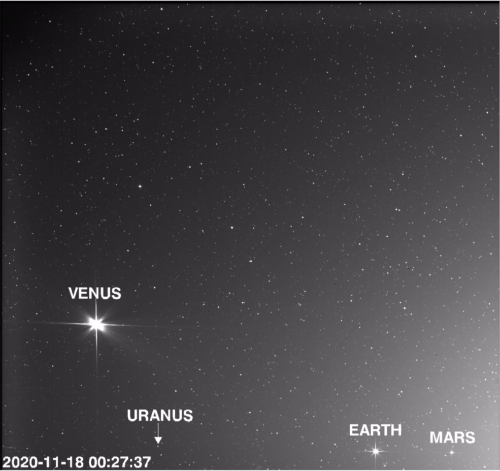 An image of space showing three bright planets (Venus, Earth, and Mars) and one faint planet, Uranus