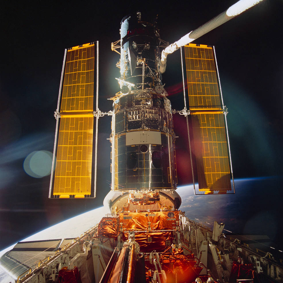spacecraft in orbit over the Earth