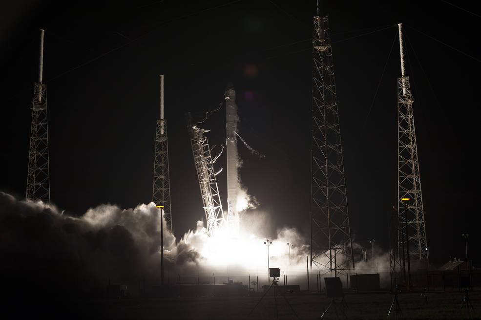 Nighttime launch of Falcon 9 rocket with Dragon capsule aboard
