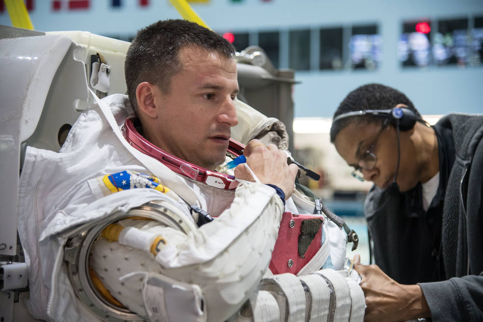 NASA astronaut Drew Morgan prepares for spacewalk training Jan. 24, 2018, in the Neutral Buoyancy Laboratory.