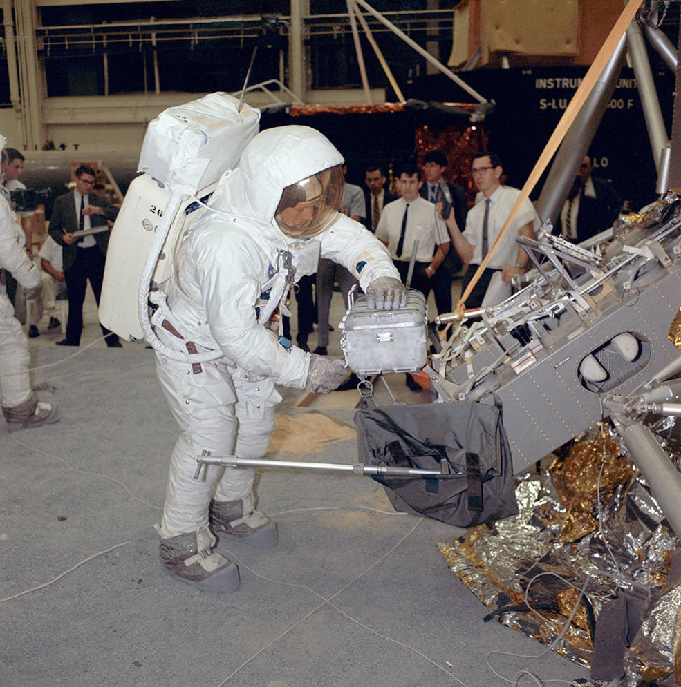Apollo 11 commander Neil Armstrong works with an Apollo Lunar Sample Return Container