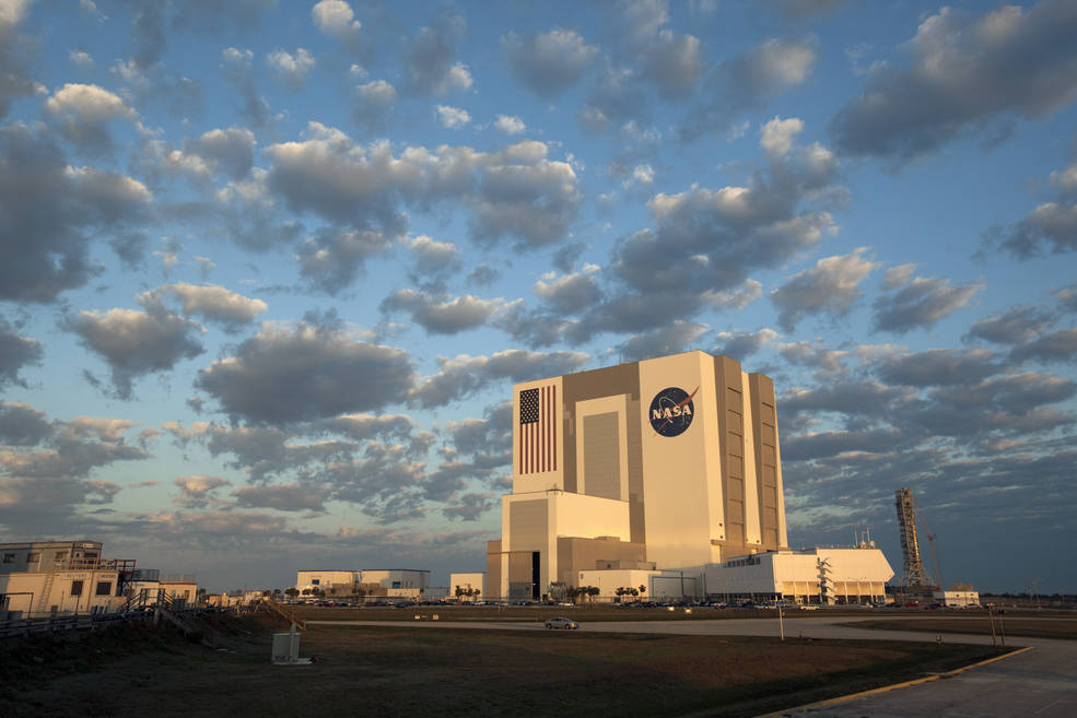 Vehicle Assembly Building at NASA Kennedy photographed in morning with clouds overhead