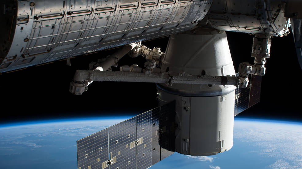 The SpaceX Dragon cargo craft is pictured attached to the Harmony module after it arrived on Dec. 17. 2017.