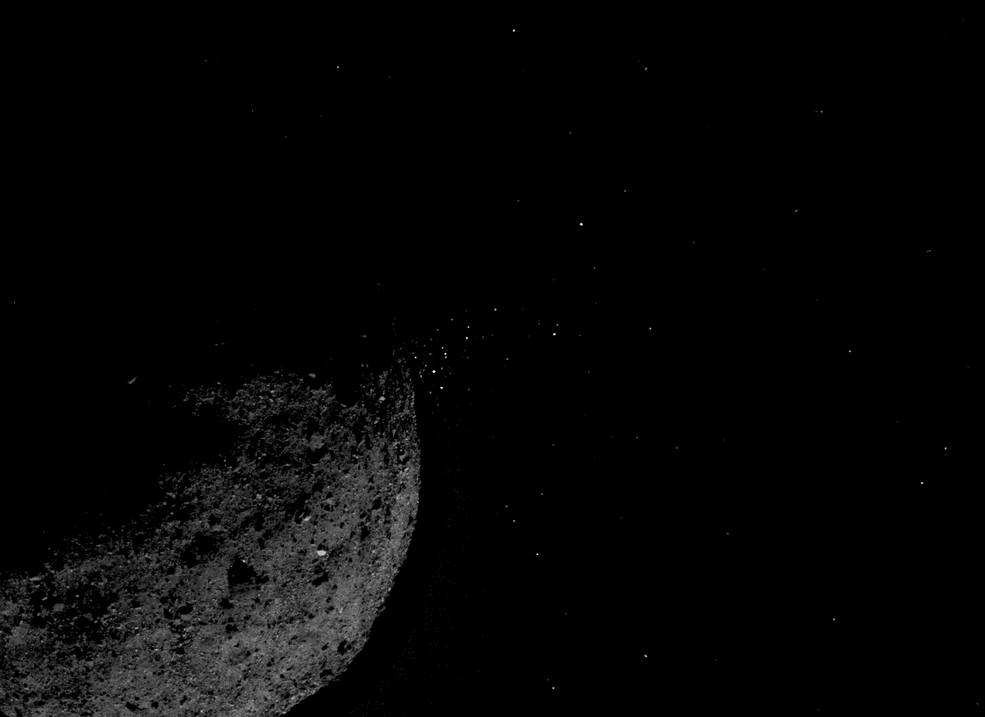 Asteroid Bennu ejecting particles from its surface on Jan. 19, created by combining two images from NASA's OSIRIS-REx spacecraft