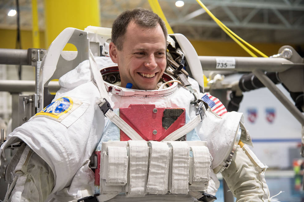 NASA astronaut Nick Hague, seen here getting into a spacesuit for spacewalk training on Dec. 7, 2017.