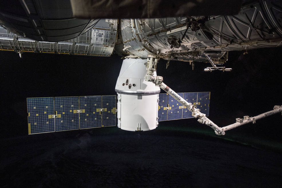 SpaceX Dragon cargo craft attached to the International Space Station's Harmony module.