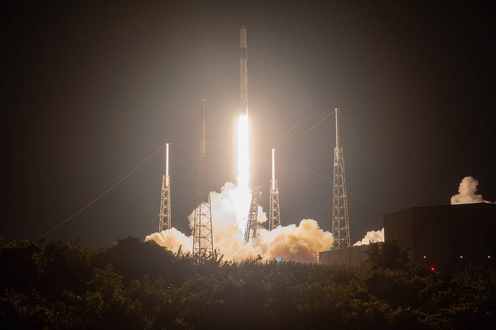 A SpaceX Falcon 9 rocket with the Dragon cargo module lifts off Space Launch Complex 40 on Cape Canaveral Air Force Station