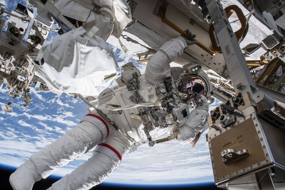NASA astronaut Drew Feustel seemingly hangs off the International Space Station while conducting a spacewalk
