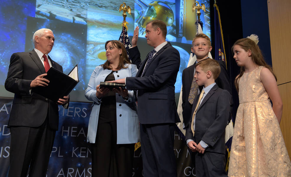 Vice President Mike Pence swears in Jim Bridenstine as the 13th NASA Administrator as Bridenstine's family watches.