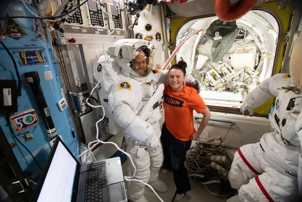 NASA astronaut Serena Auñón-Chancellor assists ESA (European Space Agency) astronaut Alexander Gerst