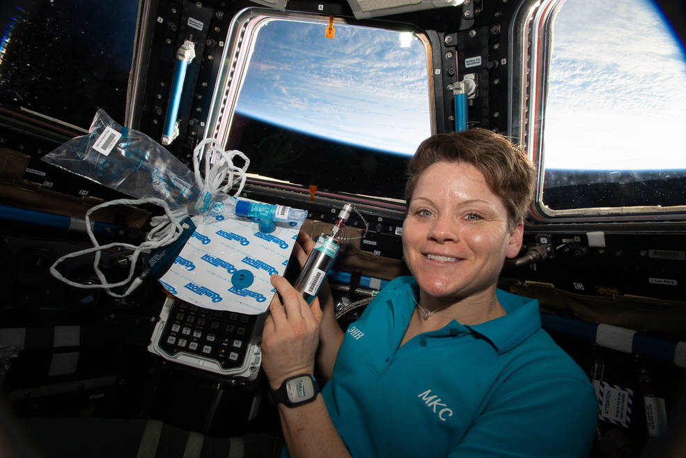 Expedition 58 Flight Engineer Anne McClain of NASA is pictured in the cupola holding biomedical gear for the Marrow experiment.