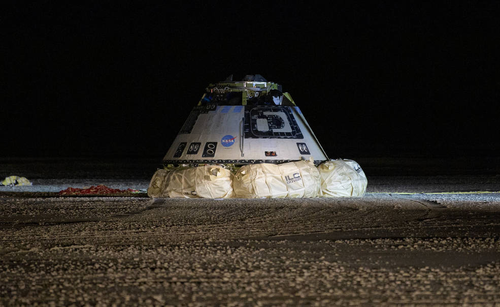 The Boeing CST-100 Starliner spacecraft lands in White Sands, New Mexico, Sunday, Dec. 22, 2019.