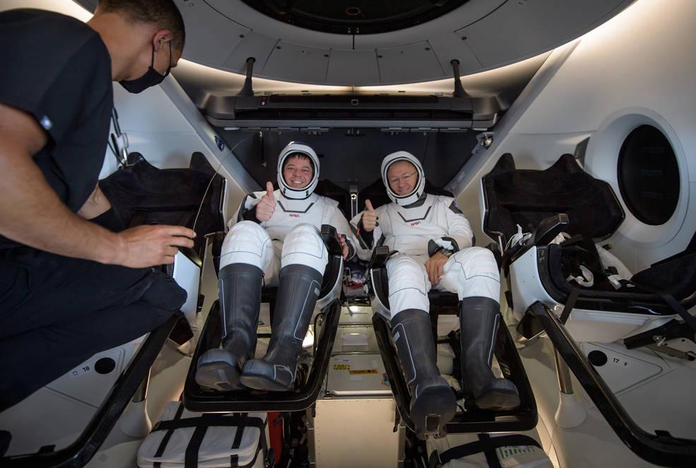 NASA astronauts Robert Behnken, left, and Douglas Hurley are seen inside the SpaceX Crew Dragon Endeavour spacecraft