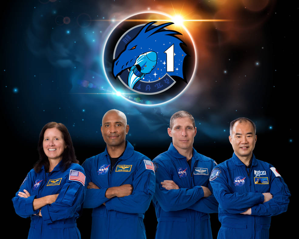 The SpaceX Crew-1 official crew portrait with (from left) Shannon Walker, Victor Glover, Mike Hopkins, and Soichi Noguchi