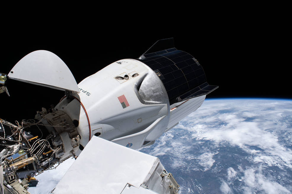 The SpaceX Crew Dragon spacecraft is pictured docked to the Harmony module's forward international docking adapter
