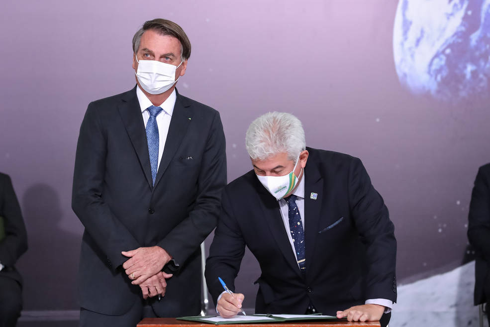 Brazil Minister of Science, Technology, and Innovation Marcos Pontes signs the Artemis Accords as President Jair Bolsonaro looks on during a ceremony at the Palácio do Planalto in Brasilia Tuesday, June 15, 2021.