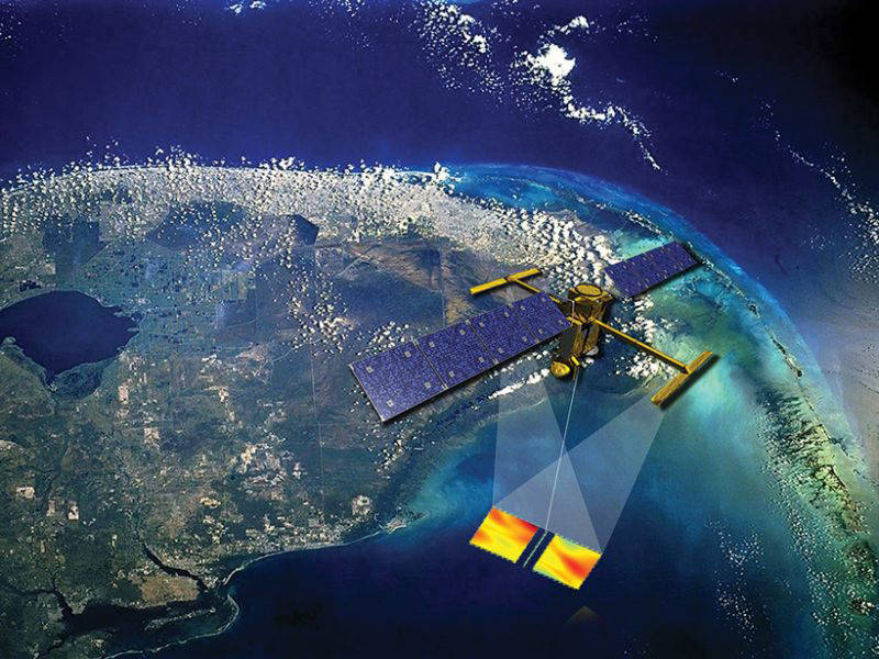 An artist's impression of the future SWOT satellite making sea surface observations from space with a slightly cloud-covered Earth below.
