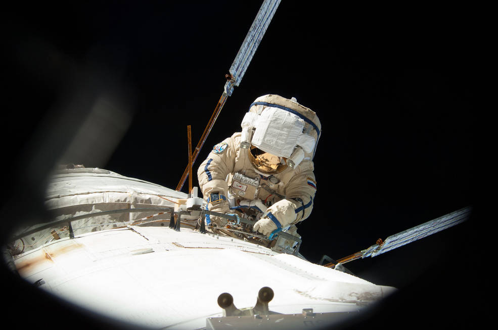 cosmonaut Alexander Misurkin conducts a spacewalk outside the International Space Station