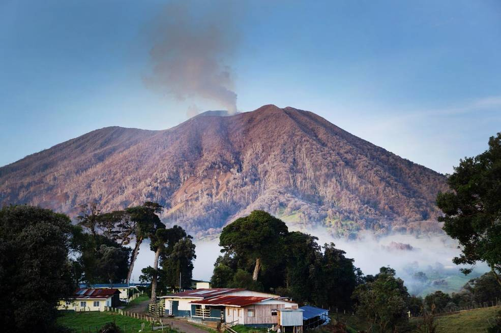 volcano on horizon, smoking
