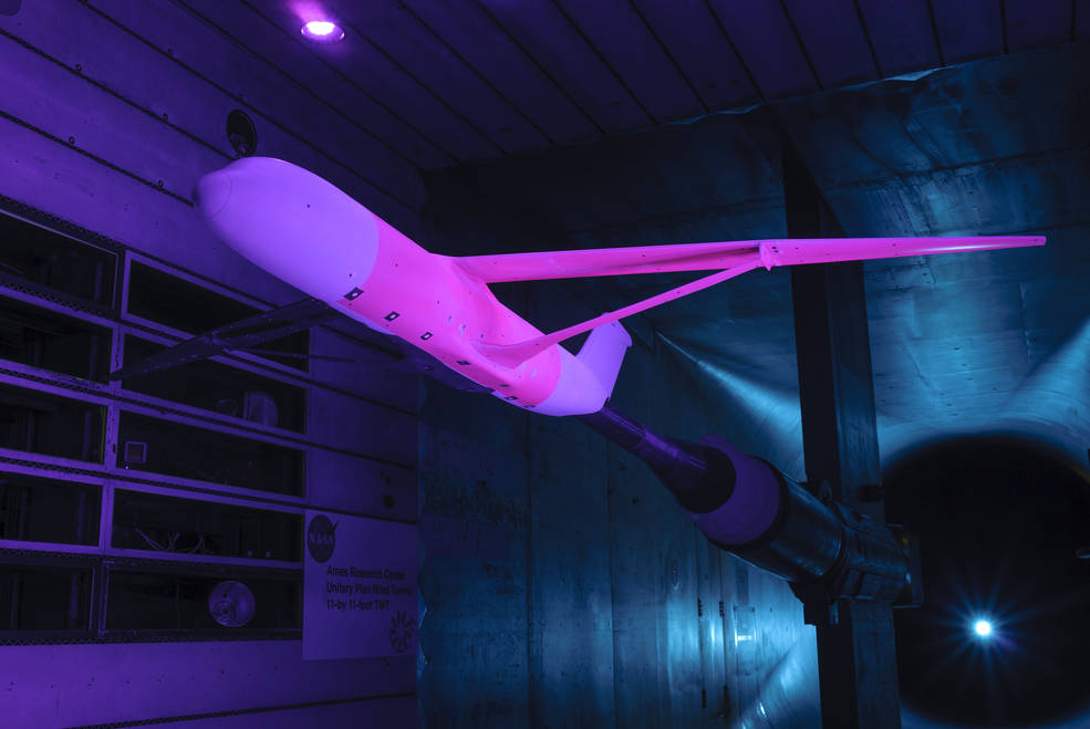 Pink-colored pressure sensitive paint is applied to a vehicle to test in a wind tunnel.