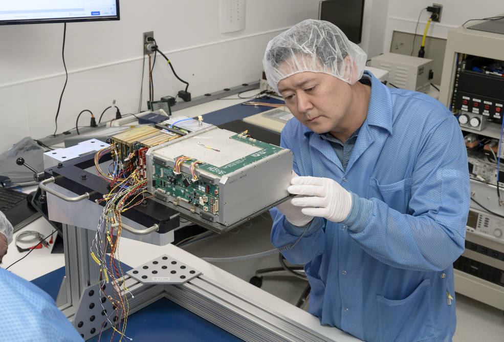 Integration and test engineer, Dan Rowan, works on internal components of BioSentinel's CubeSat.