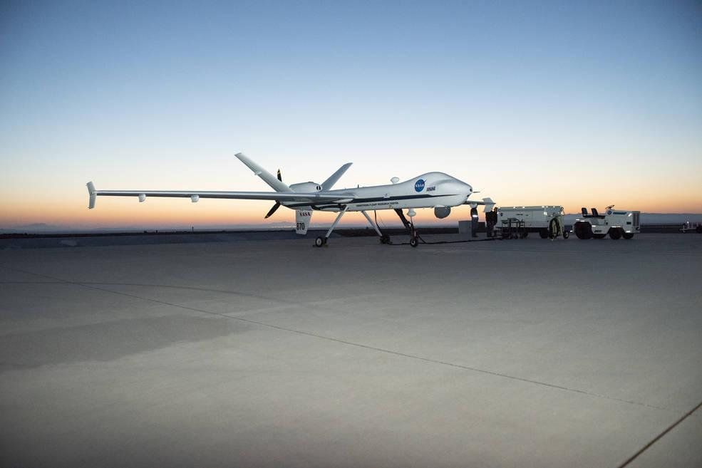 Sun Rises over NASA's Ikhana Aircraft as Armstrong Maintenance Crews Prepare the Aircraft for a Test Flight
