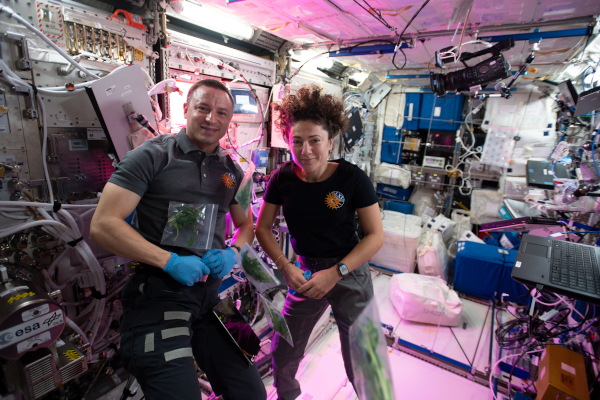 astronauts andrew morgan and jessica meir inside the space station