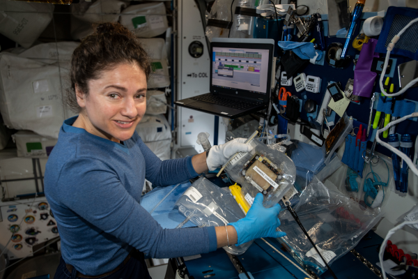 astronaut jessica meir working on sience inside the space station