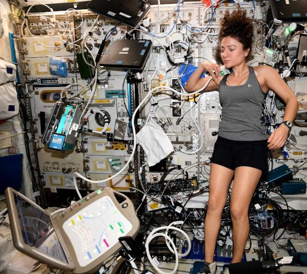 astronaut jessica meir using ultrasound equipment