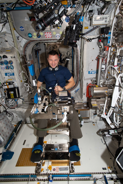 astronaut andrew morgan working inside the space station