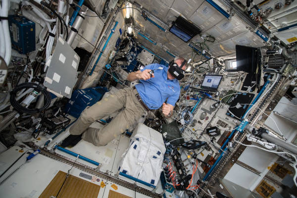 astronaut David Saint-Jacques using a virtual reality headset inside the space station
