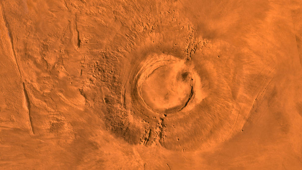 This digital-image mosaic of Mars' Tharsis plateau shows the extinct volcano Arsia Mons. It was assembled from images that the Viking 1 Orbiter took during its 1976-1980 working life at Mars.Credits: NASA/JPL/USGS