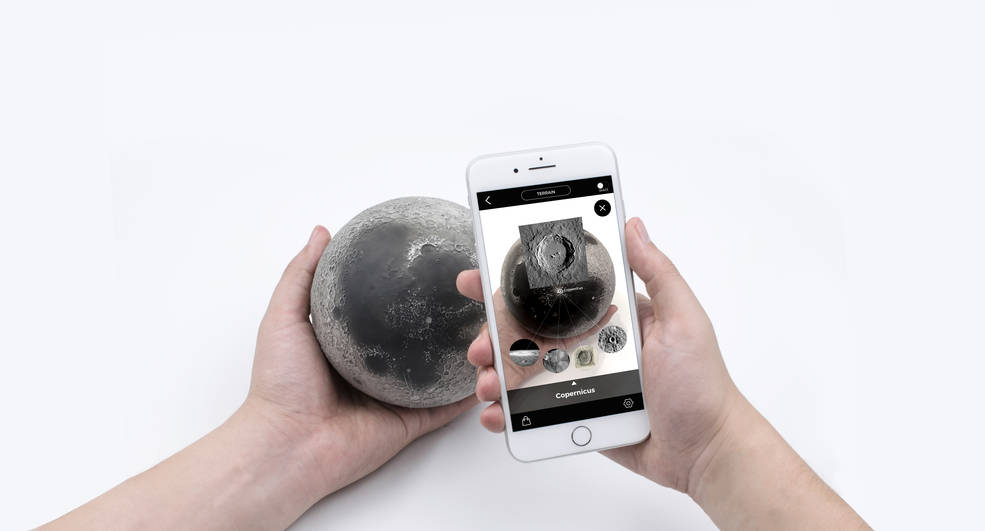 Person holding Astro Reality Moon model