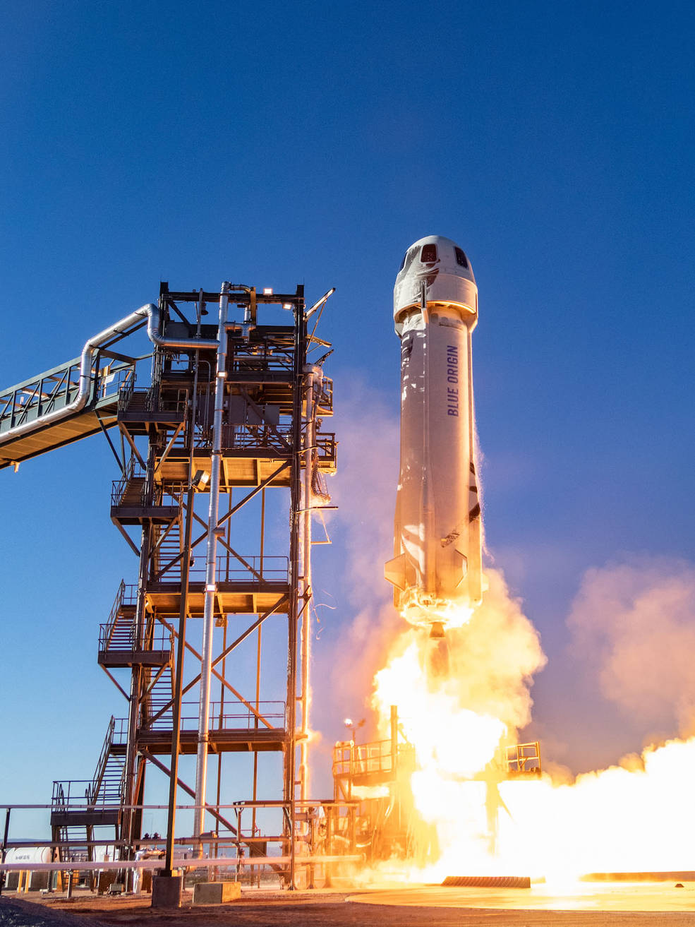 Blue Origin's New Shepard rocket system lifts off from the company's launchpad in West Texas in January 2019.