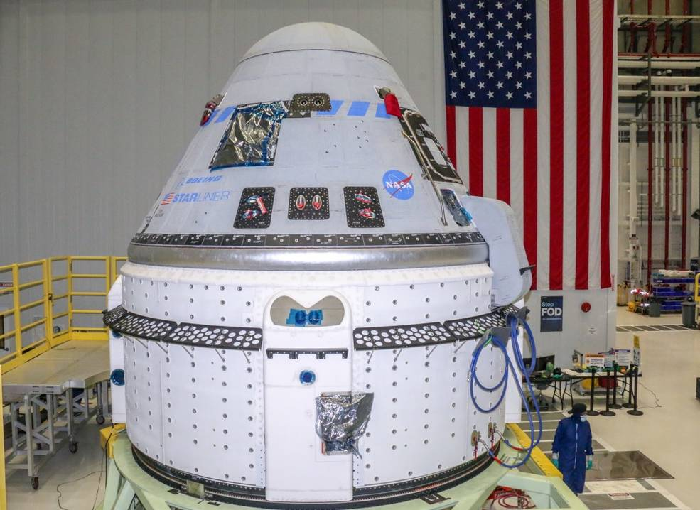 Technicians prepare Boeing's CST-100 Starliner for the company's Orbital Flight Test-2 (OFT-2) in the Commercial Crew and Cargo Processing Facility at NASA's Kennedy Space Center in Florida on June 2, 2021.