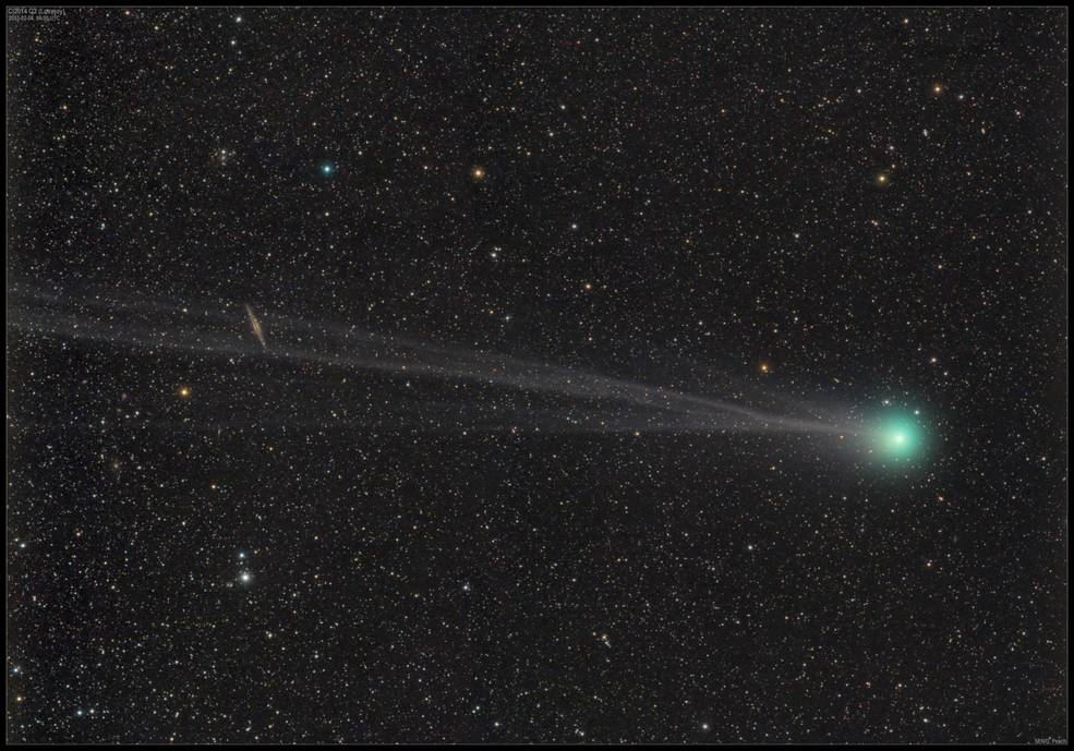 greenish comet against stars with galaxy in tail