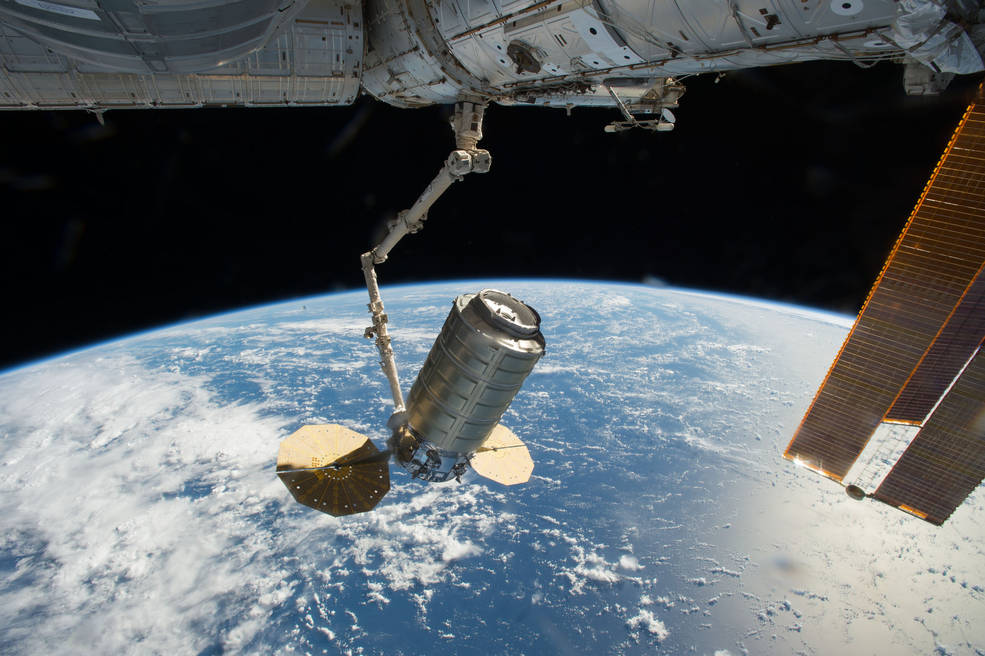 The International Space Station's Canadarm2 robotic arm captures Orbital ATK's Cygnus cargo spacecraft.
