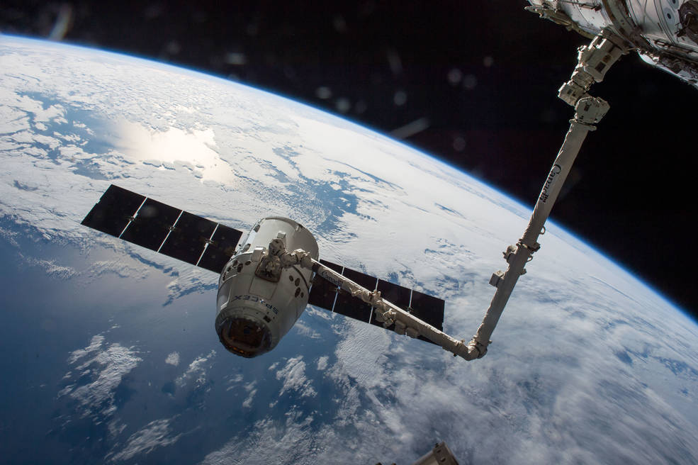 SpaceX Dragon cargo spaceship is grappled by the International Space Station's Canadarm2