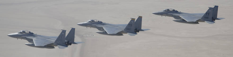 A trio of F-15D Eagles banks right as they fly over Edwards Air Force Base.