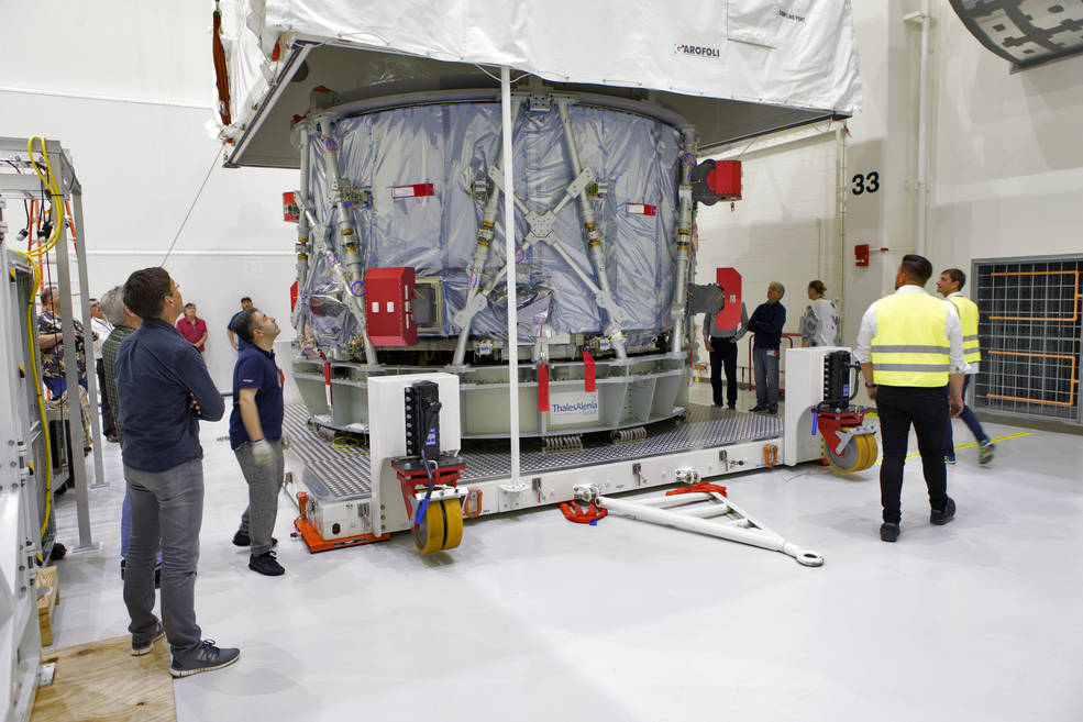 Engineers and technicians from ESA (European Space Agency) and ESA contractor Airbus uncrate Orion's European Service Module