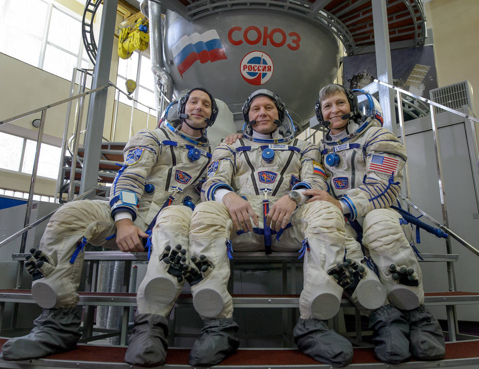 Astronauts Thomas Pesquet of ESA (European Space Agency), Oleg Novitskiy of Roscosmos, and Peggy Whitson of NASA