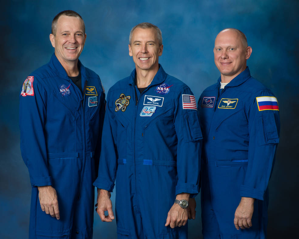 Ricky Arnold and A.J. (Drew) Feustel of NASA and Oleg Artemyev of the Roscosmos