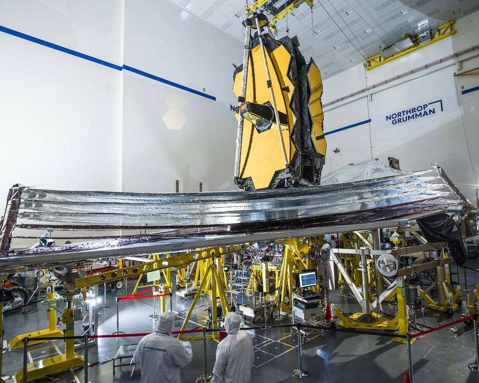 James Webb Space Telescope with people in foreground