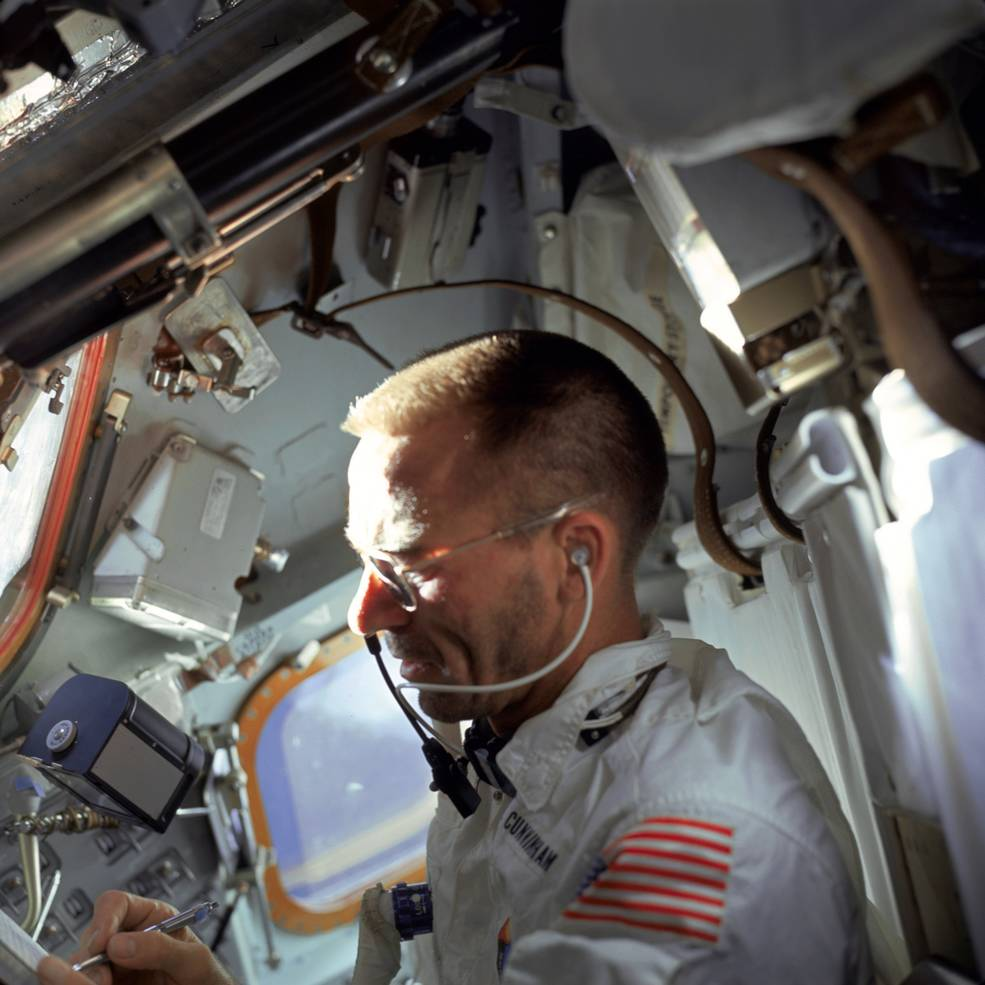 Astronaut writing in space.