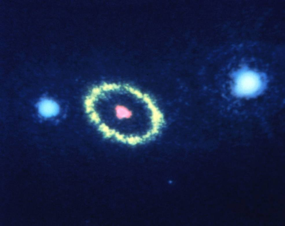 three bright spots and a ring in space